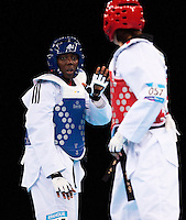 04 DEC 2011 - LONDON, GBR - Gwladys Epangue (FRA) (on left, in blue) looks for an opening to attack Sae-Bom An (KOR) during their women's +67kg category semi final contest at the London International Taekwondo Invitational and 2012 Olympic Games test event at the ExCel Exhibition Centre in London, Great Britain .(PHOTO (C) NIGEL FARROW)