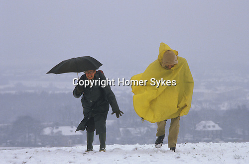 Ramblers Association South Downs Sussex England Two old age pensioners battle against snow and wind