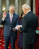 United States Vice President Joe Biden, right, administers the oath of office during a mock swearing-in ceremony to US Senator Chuck Schumer (Democrat of New York), left, prior to  in the Old US Senate Chamber in the US Capitol in Washington, DC on Tuesday, January 3, 2017.  Schumer's wife, Iris Weinshall, is in the middle partially obscured. <br /> Credit: Ron Sachs / CNP<br /> (RESTRICTION: NO New York or New Jersey Newspapers or newspapers within a 75 mile radius of New York City)