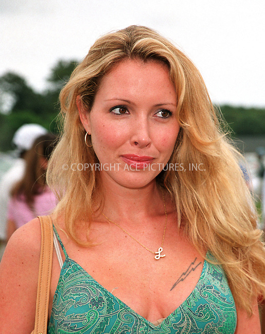 "Lulu Johnson (daughter of Betsey Johnson) at the Fifth Annual ""Super Saturday"" designer sale and family event to benefit the ovarian cancer research fund. Water Mill, Long Island. July 27, 2002. Please byline: Alecsey Boldeskul/NY Photo Press.   ..*PAY-PER-USE*      ....NY Photo Press:  ..phone (646) 267-6913;   ..e-mail: info@nyphotopress.com"