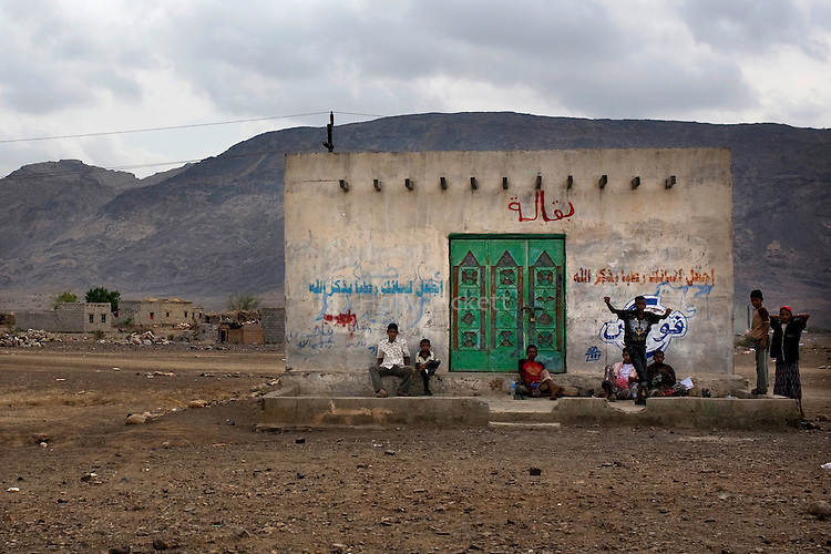 Men keep watch outside of a building along the road between Taezz and Aden, Yemen, Nov. 30, 2009. A raging conflict with Houthi rebels in Yemen's north and clashes with separatists in the South continue to erode stability in the Arabian Peninsula's poorest state, where half of the population lives in abject poverty.