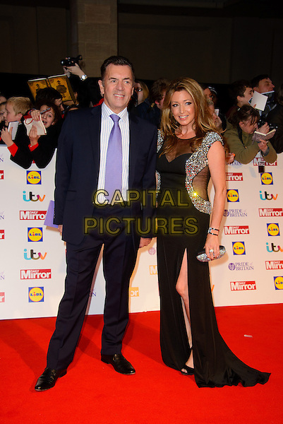 Duncan Bannatyne, Julie Kendell<br /> The Daily Mirror's Pride of Britain Awards arrivals at the Grosvenor House Hotel, London, England.<br /> 7th October 2013<br /> full length black suit blue dress sheer couple<br /> CAP/CJ<br /> &copy;Chris Joseph/Capital Pictures