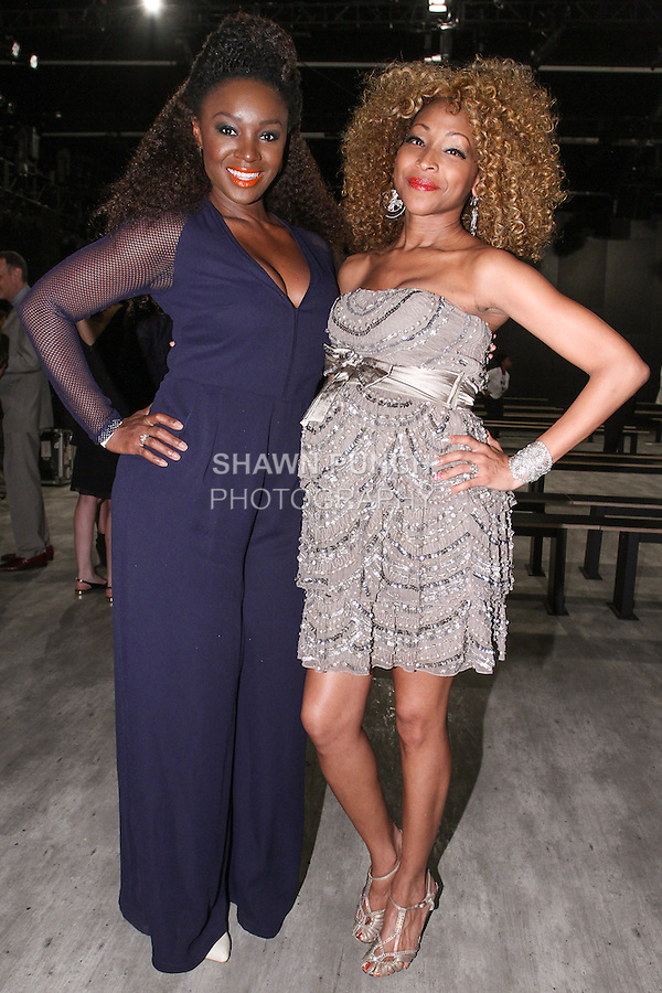 (L-R) Singers Saycon Sengbloh and N'Kenge attend the b michael AMERICA Couture Spring 2015 fashion show during Mercedes-Benz Fashion Week Spring 2015 in New York City.