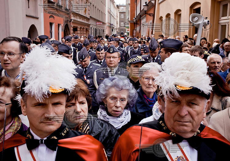 Knights of Columbus, pilgrims and orchestra members outside Poznan's Fara Church during celebrations marking the 1050 anniversary of the Polish adoption of Catholicism (the Baptism of Poland).
