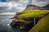 Iconic village of Gásadalur and its Múlafossur waterfall on the Faroe Islands