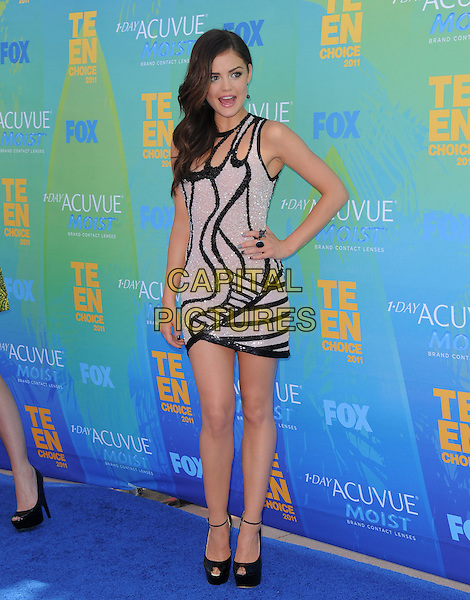 Lucy Hale.The Fox 2011 Teen Choice Awards held at Gibson Ampitheatre in Universal City, California, USA..August 7th, 2010                    .full length ankle strap black platform peep toe patent beige print dress hand on hip beads beaded .CAP/RKE/DVS.©DVS/RockinExposures/Capital Pictures.
