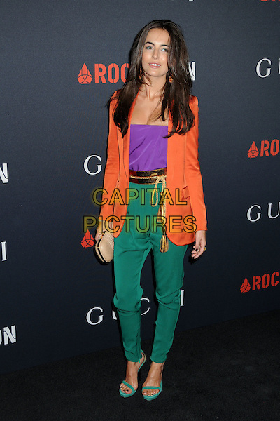 CAMILLA BELLE.Gucci and Rocnation Pre-Grammy Brunch held at Soho House, West Hollywood, California, USA, .12th February 2011..full length green trousers orange jacket purple top  open toe sandals harem pants gold belt tassel beige nude clutch bag colour block .CAP/ADM/BP.©Byron Purvis/AdMedia/Capital Pictures.