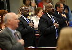 Nevada Sen. Kelvin Atkinson, D-North Las Vegas, pays the Pledge of Allegiance with Assembly Majority Leader William Horne, D-Las Vegas on the Assembly floor at the Legislative Building in Carson City, Nev., on Wednesday, April 24, 2013. Atkinson was on the Assembly floor to show support as Assemblyman Tyrone Thompson, D-North Las Vegas, took the oath of office. .Photo by Cathleen Allison