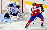 10 April 2010: Montreal Canadiens' left wing forward Travis Moen is unable to score against goaltender Jean-Sebastien Giguere during the last game of the regular season against the Toronto Maple Leafs at the Bell Centre in Montreal, Quebec, Canada. The Leafs defeated the Habs 4-3 in sudden death overtime as the Canadiens advance to the Stanley Cup Playoffs with the single point. Mandatory Credit: Ed Wolfstein Photo
