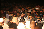 """Palestinian Prime Minister in Gaza Ismail Haniyeh (not seen) leads a night prayer known as """"Tarawih"""" at a sit-in tent in Gaza city, solidarity with Egyptian soldiers who were killed on Rafah border between Egypt and the southern Gaza Strip, on 06 August 2012.  Media reports state that 16 Egyptian security forces were killed and seven others injured on 05 August when militants opened fire on a checkpoint and commandeered vehicles during a Ramadan fast in Rafah. Having hijacked the vehicles, they raced to the nearby Kerem Shalom/Karm Abu Salem crossing point on the Egypt-Israel-Gaza border. Egyptian authorities closed the border crossing with the Gaza Strip at Rafah indefinitely. Photo by Majdi Fathi"""