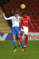 Kai Naismith of Portsmouth and Charlton's Naby Sarr in an aerial challenge during Charlton Athletic vs Portsmouth, Checkatrade Trophy Football at The Valley on 7th November 2017