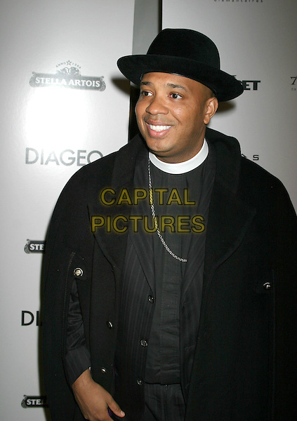 "REVEREND RUN.""After The Sunset"" - New York Premiere - Arrivals, New York City, New York .November 9th, 2004.half length, collar, hat.www.capitalpictures.com.sales@capitalpictures.com.© Capital Pictures."