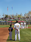 Reno Aces' Tyler Bortnick and Adam Garren listen to the National Anthem before a baseball game against the Sacramento River Cats in Reno, Nev., on Sunday, April 14, 2013. The River Cats won 22-6..Photo by Cathleen Allison