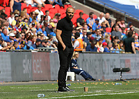 27th May 2018, Wembley Stadium, London, England;  EFL League 1 football, playoff final, Rotherham United versus Shrewsbury Town;  Rotherham United player walk past the real Rotherham United manager Paul Warne looks on from the touchline
