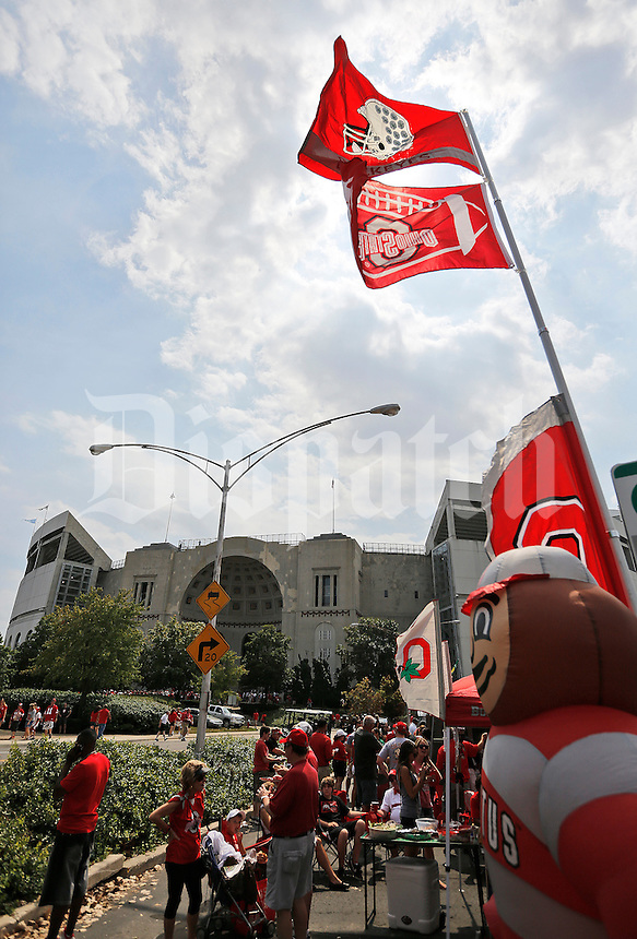 Fans tailgate outside Ohio Stadium prior to the NCAA football game between Ohio State and San Diego State at Ohio Stadium in Columbus on Sept. 7, 2013. (Adam Cairns / The Columbus Dispatch)