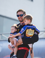 Sep 5, 2016; Clermont, IN, USA; NHRA top fuel driver Morgan Lucas with sons Hunter Lucas and Austin Lucas during the US Nationals at Lucas Oil Raceway. Mandatory Credit: Mark J. Rebilas-USA TODAY Sports