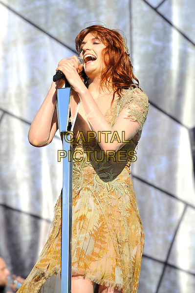 Florence Welch of Florence and the Machine .Performing at the BBC Radio1 Hackney Weekend, Hackney Marshes, London, England. .24th June 2012.on stage in concert live gig performance music half length yellow white dress singing .CAP/MAR.© Martin Harris/Capital Pictures.
