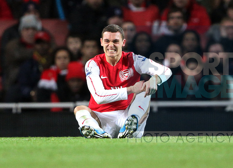 Arsenals Thomas Vermaelen looks on dejected