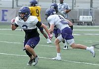 NWA Democrat-Gazette/DAVID GOTTSCHALK Fayetteville High School receiver Connor Flannigan runs an offensive play Monday, May 14, 2018 at Harmon Stadium in Fayetteville.