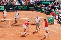 15-09-12, Netherlands, Amsterdam, Tennis, Daviscup Netherlands-Suisse, Doubles, Robin Haase/Jean-Julian Rojer  vs   Roger Federer/Stanislas Wawrinka.(foreground) discusssing a linecall
