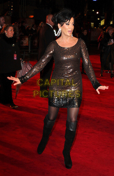 NANCY DELL'OLIO.Attending the Royal Film Performance of 'The Lovely Bones' at the Odeon, Leicester Square, London, England, UK,.November 24th 2009..full length black knee high boots tights sequin sequined dress black brown bronze hands arms long sleeved sleeves .CAP/ROS.©Steve Ross/Capital Pictures.