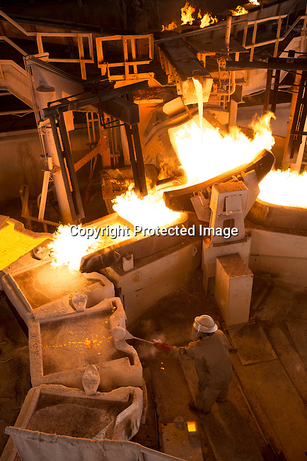 MUFULIRA, ZAMBIA- JULY 6: An employee works at the copper smelter at Mopani Mines on July 6, 2016 in Mufulira, Zambia.The copper is trucked to ports such as Dar es Salaam, Tanzania & Durban, South Africa. Glencore, an Anglo-Swiss multinational commodity trading and mining company, owns about 73 % of Mopani mines, which produces copper and some cobalt. The mine employs about 15,000 people. Many people in the area are dependent of the mines and its subcontractors for work. (Photo by Per-Anders Pettersson)
