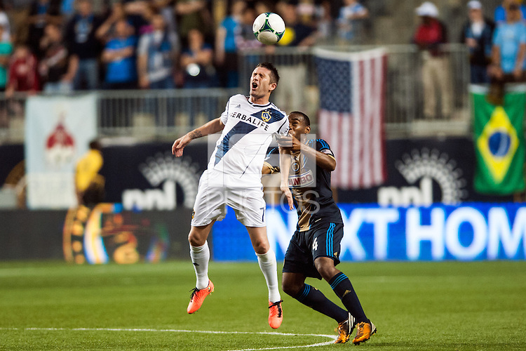 Robbie Keane (7) of the Los Angeles Galaxy heads the ball. The Los Angeles Galaxy defeated the Philadelphia Union 4-1 during a Major League Soccer (MLS) match at PPL Park in Chester, PA, on May 15, 2013.