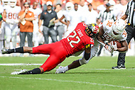 Landover, MD - September 1, 2018: Maryland Terrapins linebacker Isaiah Davis (22) tackles Texas Longhorns running back Daniel Young (32) during the game between Texas and Maryland at  FedEx Field in Landover, MD.  (Photo by Elliott Brown/Media Images International)