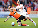 United's Johnny Russell is challenged by Aberdeen's Russell Anderson    ...