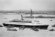 07 May 1969 . The Queen Elizabeth II cruise liner passing Liberty Island on her maiden voyage from Southampton, England to New York City.