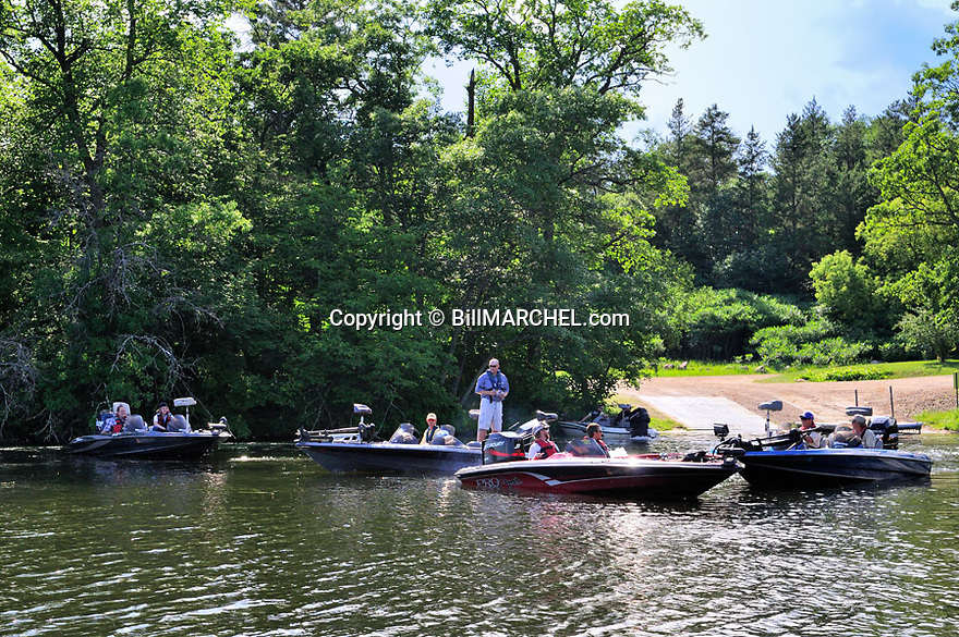 T35M:00416-029.16 Fishing:  Group of bass boats are at boat landing.  Fish, river, lake, angle, crowds, crowded.