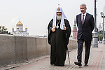 Kirill I, patriarch of the Russian Orthodox Church, left, talks with Moscow Mayor Sergei S. Sobyanin during a campaign appearance on the Moscow River embankment along the Kremlin walls on Thursday, August 29, 2013 in Moscow, Russia.