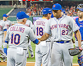 New York Mets manager Terry Collins (10) congratulates relief pitcher Jeurys Familia (27) following the final out in their team's 7 - 2 victory over  the Washington Nationals at Nationals Park in Washington, D.C. on Tuesday, July 21, 2015. <br /> Credit: Ron Sachs / CNP<br /> (RESTRICTION: NO New York or New Jersey Newspapers or newspapers within a 75 mile radius of New York City)