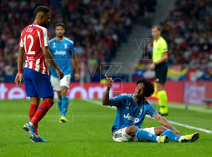 MADRID-ESPAÑA, 18-09-2019: Ranan Lodi de Atlético de Madrid y Juan Guillermo Cuadrado de Juventus, durante partido de la fase de grupos por la Liga de Campeones de la UEFA, entre Atlético de Madrid y Juventus en el estadio Wanda Metropolitano de la ciudad de Madrid, España. / Ranan Lodi of Atletico de Madrid and Juan Guillermo Cuadrado of Juventus during the group stage match for the UEFA Champions League, between Atletico de Madrid and Juventus at the Wanda Metropolitano stadium in the city of Madrid, Spain. Photo: ChakanaNews / Patricio Realpe / VizzorImage.