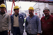 Bratislava, Slovakia: factory workers in hard hats and overalls.