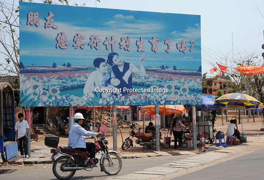 "A propaganda billboard in Dangzhou that reads ""Friend,have you taken the birth-control measures yet?"". Dangzhou on Hainan Island, China is the epicentre of China's gender imbalance problem. Hainan has a national average of 136 males for every 100 females born and Dangzhou has 168 males for every 100 born."