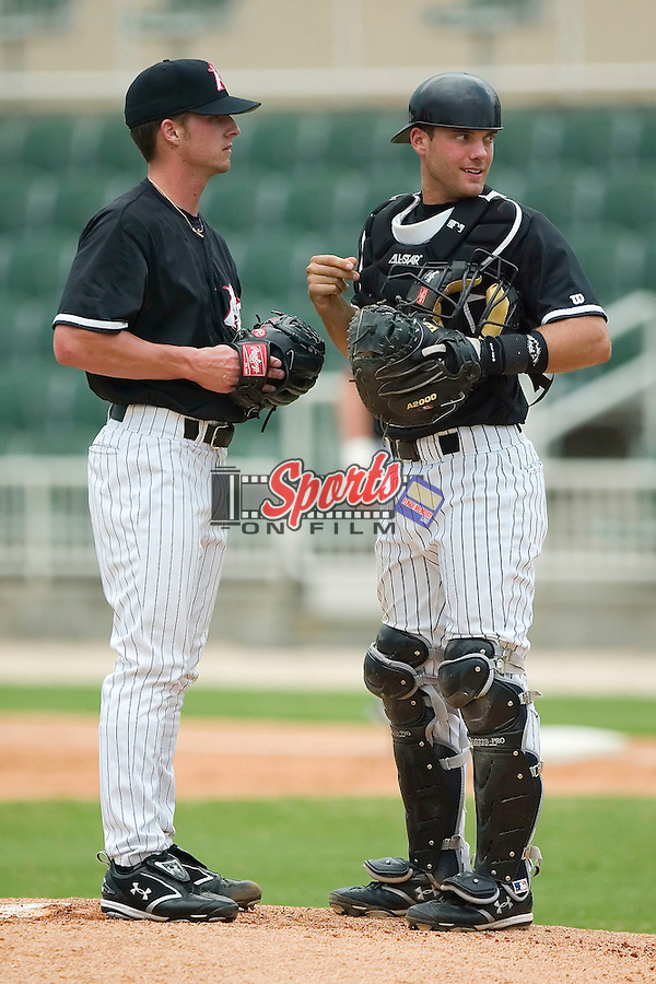 Kannapolis starting pitcher Justin Edwards (40) and catcher Matt Sharp (18) have a discussion on the mound versus Hickory at Fieldcrest Canon Stadium in Kannapolis, NC, Wednesday, June 27, 2007.