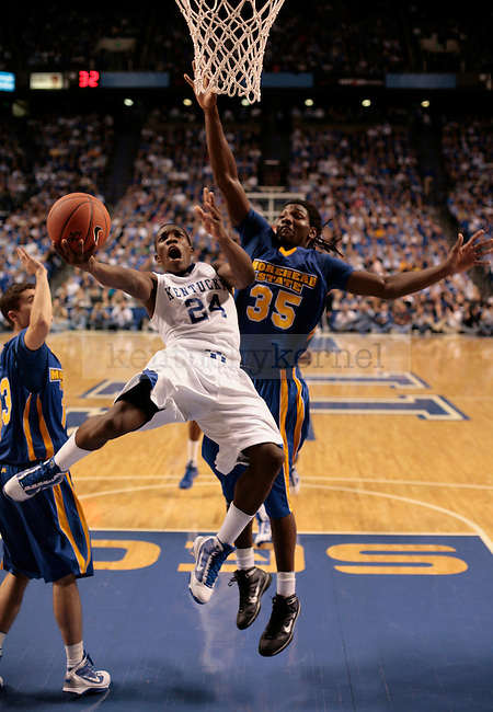 Freshman guard Eric Bledsoe attempts a layup past Morehead State guard Kenneth Faried during UK's 75-59 win over the Eagles in Rupp arena on Nov. 13, 2009...Ed Matthews | Staff