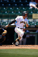 Bradenton Marauders center fielder Casey Hughston (17) follows through on a swing during a game against the Charlotte Stone Crabs on April 9, 2017 at LECOM Park in Bradenton, Florida.  Bradenton defeated Charlotte 5-0.  (Mike Janes/Four Seam Images)