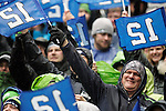 Seattle Seahawks fans wave 12th Man flags during their game with the  New Orleans  during the 2nd round in a NFL Western Division playoff game at CenturyLink Field in Seattle, Washington on January 11, 2014.  Seahawks beat the Saints 22-15 to take home-field advantage in the NFL Championship Game. ©2014. Jim Bryant Photo. ALL RIGHTS RESERVED.