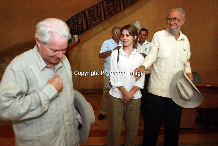 Cuba Trip.Scanned 11/21/2003.Erik Kellar/Staff..HATS OFF.J. Parke Wright, left, is humbled by the praises of Ramon Castro Ruz, President Fidel CastroÕs older brother. Ramon Castro was serving as a sort of goodwill ambassador during a dinner at the former Soviet UnionÕs Friendship House in Havana. He spoke of the relationships that need to be built between Americans and Cubans. Erik Kellar/Naples Daily News