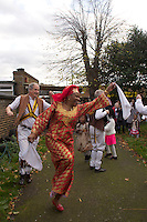 Abbey Wood local tries out morris dancing, Abbey Wood, London, UK, with the Greenwich morris dancers