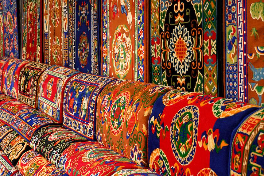 Tibetan carpets for sale at market stall on Barkhor pilgrim circuit, Lhasa, Tibet.