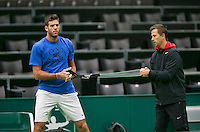 08-02-14, Netherlands,Rotterdam,Ahoy, ABNAMROWTT,, ,  Juan-Martin Del Potro (ARG) has arrived and is warming up with his coach Franco Davín.<br />