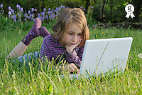 Girl (7-8) using laptop in garden (Licence this image exclusively with Getty: http://www.gettyimages.com/detail/81867360 )