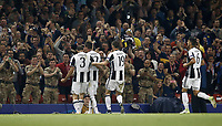Calcio, Champions League: finale Juventus vs Real Madrid. Cardiff, Millennium Stadium, 3 giugno 2017.<br /> <br /> during the Champions League final match between Juventus&rsquo; Mario Mandzukic, second from left, celebrates with his teammates Giorgio Chiellini, left, Leonardo Bonucci, second from right, and Sami Khedira, after scoring Juventus and Real Madrid at Cardiff's Millennium Stadium, Wales, June 3, 2017. <br /> UPDATE IMAGES PRESS/Isabella Bonotto