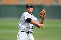 Second baseman Hunter Cole (19) of the Augusta GreenJackets warms up before a game against the Greenville Drive on Sunday, April 12, 2015, at Fluor Field at the West End in Greenville, South Carolina. Augusta won, 2-1. (Tom Priddy/Four Seam Images)