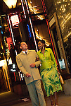 African American couple strolling in city at night