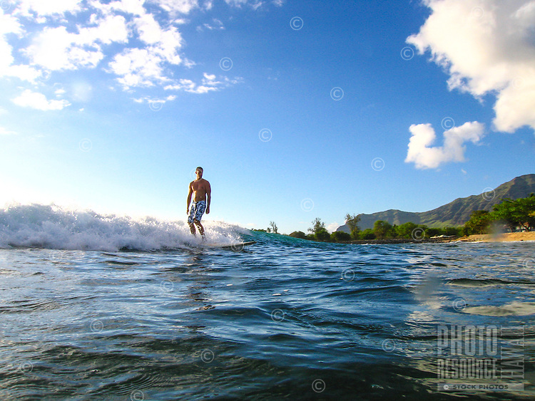 A man surfs near Rest Camp, or Pilila'au Army Recreation Center, in Poka'i Bay, West O'ahu.