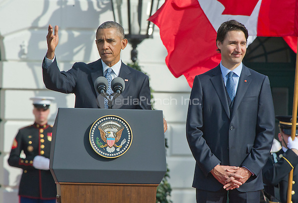 United States President Barack Obama, left, makes remarks as Prime Minister Justin Trudeau of Canada, right, listens during an Arrival Ceremony opening the Official Visit of , and Mrs. Sophie Gr&Egrave;goire Trudeau on the South Lawn of the White House in Washington, DC on Thursday, March 10, 2016. <br /> Credit: Ron Sachs / CNP/MediaPunch